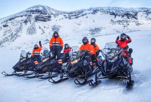 A Group Of Friends Get Ready FFor Snowmobiling.