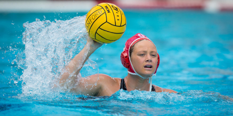 A Female Water Polo Player In An Action.