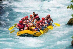 Group of People Having Fun During River Rafting.