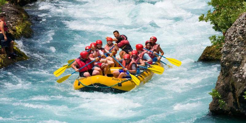 Group of People Having Fun During River Rafting.