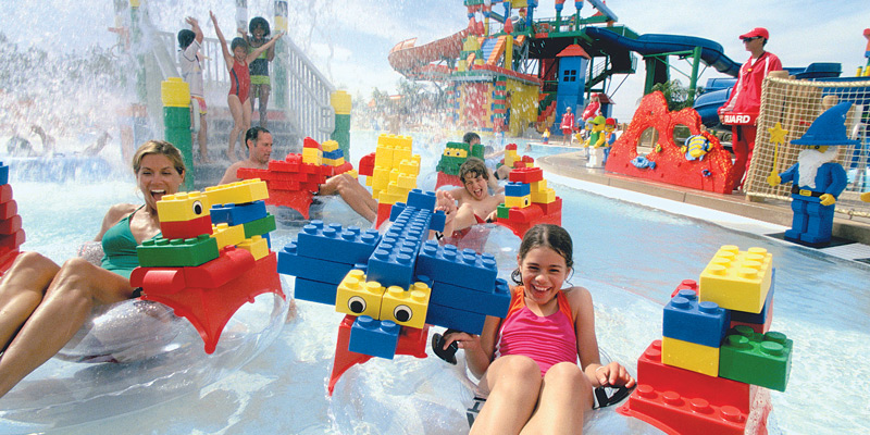 Group of Kids Playing With Water Toys.