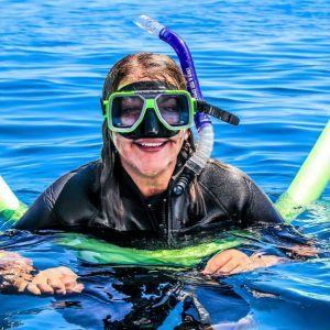 A Woman Wearing Swim Suit And Goggles For Scuba Diving.