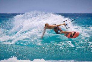 A man Enjoying Skateboarding In The Sea.