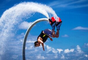 An Image Representing Flyboarding of A man.