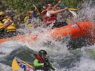 Adventurous Sports - River Rafting By Group of People.