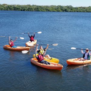 An Image of Multiple Boats With People - Kayaking Concept.